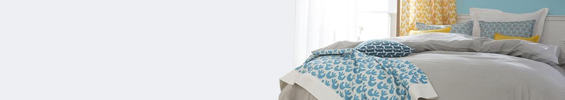 Bettdecken, Kissen & Nackenrollen