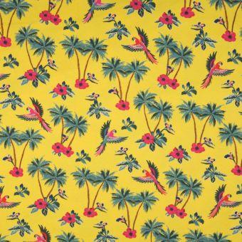 Jerseystoff aus Baumwolle mit Papageien Palmenmuster gelb